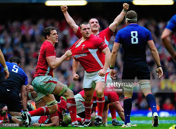 Wales players Ian Evans Ken Owens and prop Gethin Jenkins celebrate on the final whistle after winning the Grand Slam after the RBS Six Nations match...