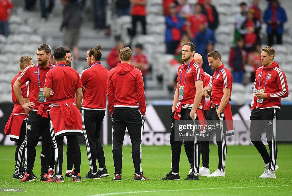 Wales players inspect the pitch prior to the UEFA EURO 2016 quarter final match between Wales and Belgium at Stade Pierre-Mauroy on July 1, 2016 in Lille, France.