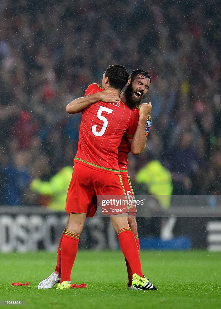 Wales players James Chester (l) and Joe Ledley celebrate on the final whistle after the UEFA EURO Group B 2016 Qualifier between Wales and Belguim at Cardiff City stadium on June 12, 2015 in Cardiff, United Kingdom.
