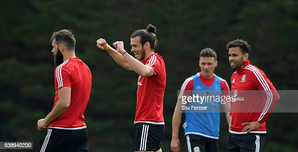 Wales players Joe Ledley Gareth Bale James Chester and Hal RobsonKanu share a joke during a Euro 2016 Wales training session at the Wales training...