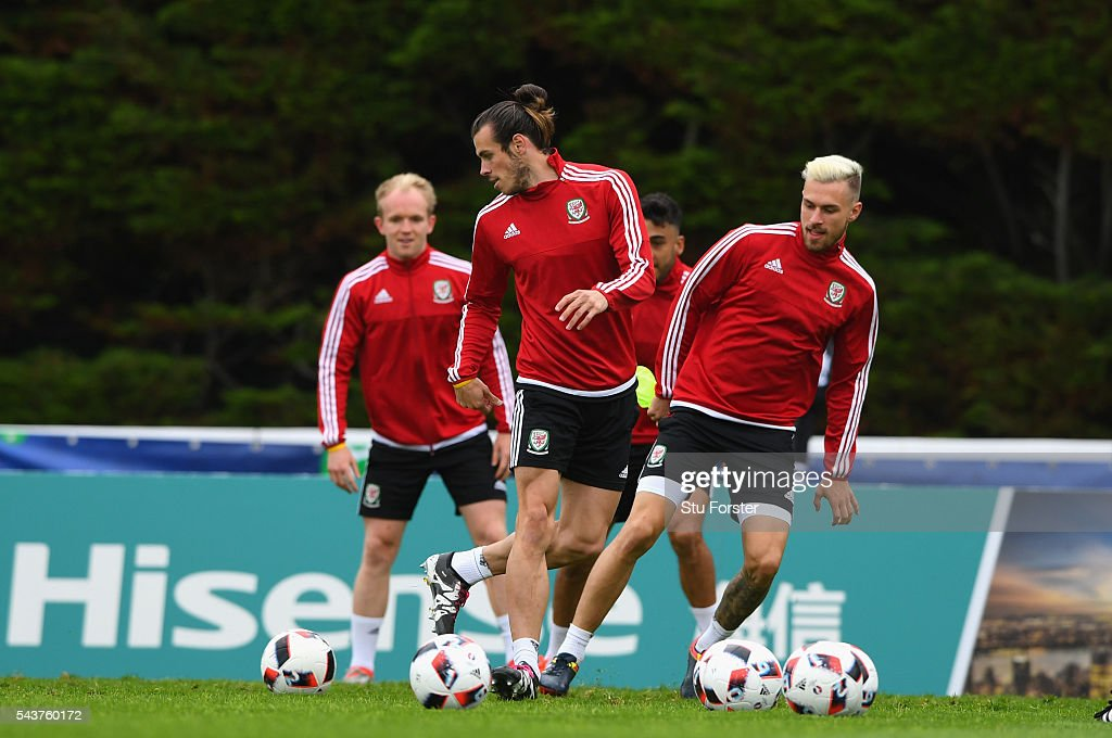 Wales players Jonathan Williams (l) <a gi-track='captionPersonalityLinkClicked' href=/galleries/search?phrase=Gareth+Bale&family=editorial&specificpeople=609290 ng-click='$event.stopPropagation()'>Gareth Bale</a> (c) and <a gi-track='captionPersonalityLinkClicked' href=/galleries/search?phrase=Aaron+Ramsey+-+Soccer+Player&family=editorial&specificpeople=4784114 ng-click='$event.stopPropagation()'>Aaron Ramsey</a> in action during Wales training session ahead of their Euro 2016 quarter final match against Belgium at their base camp on June 30, 2016 in Lille, France.