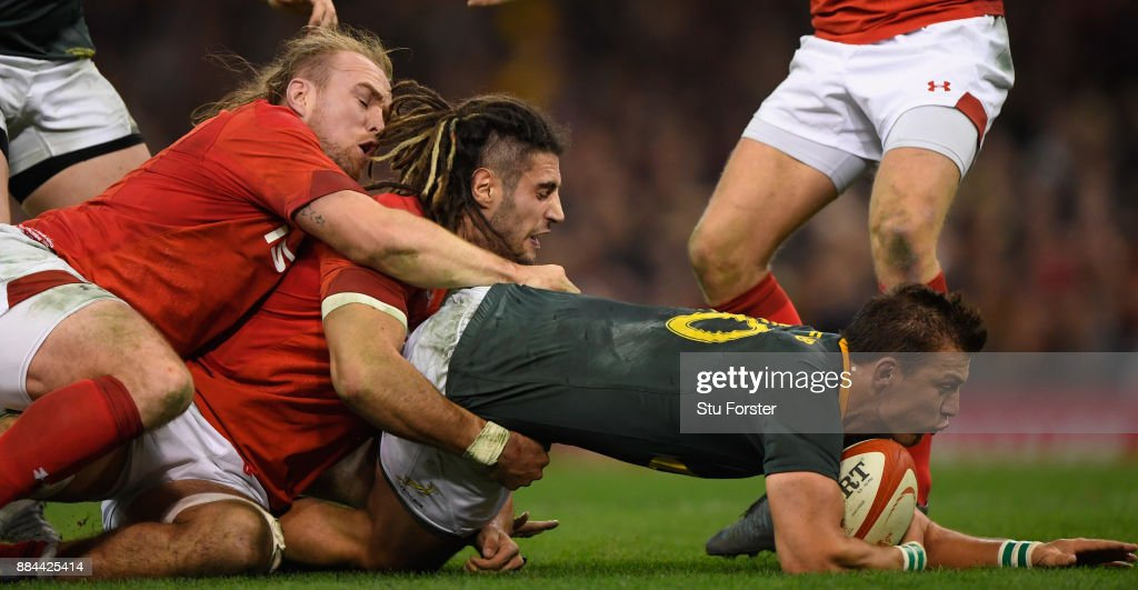 Wales players Kristian Dacey (l) and Josh Navidi combine to tackle Handre Pollard of the Springboks during the International between Wales and South Africa at at Principality Stadium on December 2, 2017 in Cardiff, Wales.