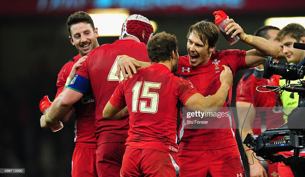 Wales players <a gi-track='captionPersonalityLinkClicked' href=/galleries/search?phrase=Leigh+Halfpenny&family=editorial&specificpeople=4232760 ng-click='$event.stopPropagation()'>Leigh Halfpenny</a> (back) and <a gi-track='captionPersonalityLinkClicked' href=/galleries/search?phrase=Liam+Williams&family=editorial&specificpeople=7852399 ng-click='$event.stopPropagation()'>Liam Williams</a> celebrate after the Autumn international match between Wales and South Africa at Millennium Stadium on November 29, 2014 in Cardiff, Wales.