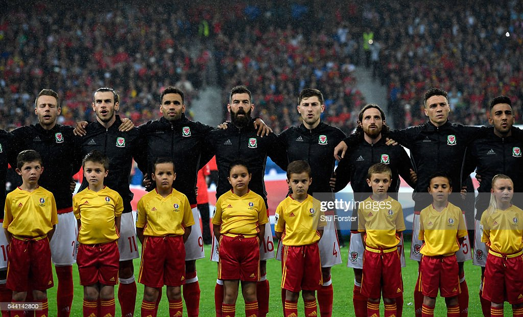 Wales players line up for the national anthem prior to the UEFA EURO 2016 quarter final match between Wales and Belgium at Stade Pierre-Mauroy on July 1, 2016 in Lille, France.