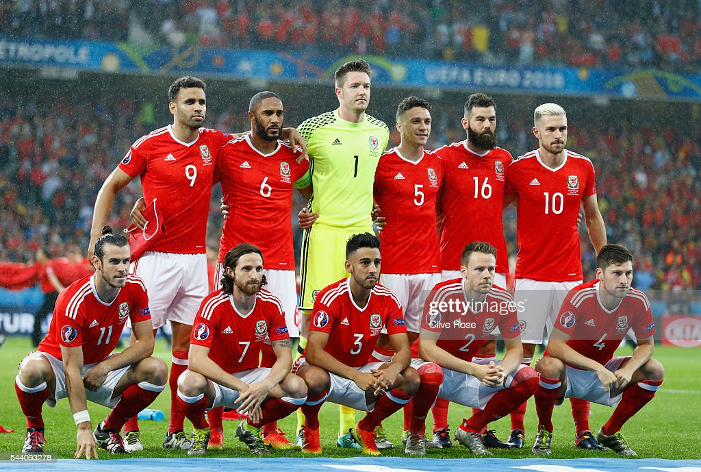 Wales players line up for the team photos prior to the UEFA EURO 2016 quarter final match between Wales and Belgium at Stade Pierre-Mauroy on July 1, 2016 in Lille, France.