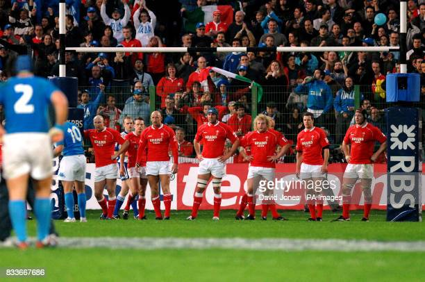 Wales players line up under their posts as Italy's Ramiro Pez seals victory with a conversion during the RBS 6 Nations match at the Stadio Flaminio...