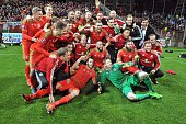 Wales' players pose after the Euro 2016 qualifying football match between Bosnia and Herzegovina and Wales in Zenica on October 10 2015 The Bosnian...