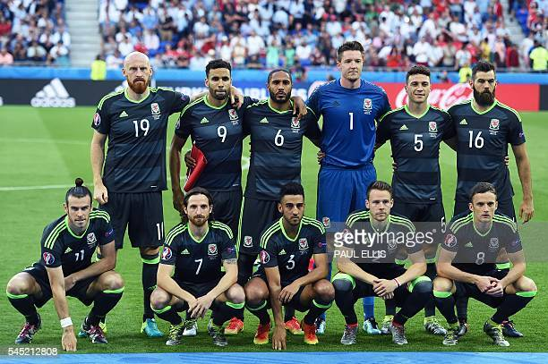 Wales players pose ahead of the Euro 2016 semifinal football match between Portugal and Wales at the Parc Olympique Lyonnais stadium in...