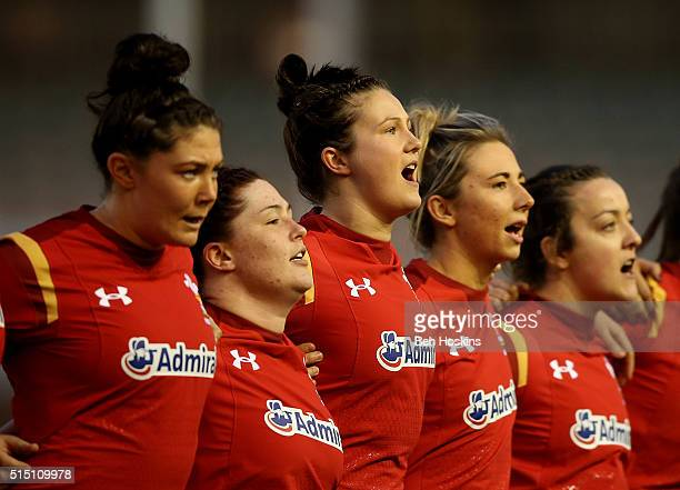 Wales players sing the national anthem ahead of the Womens Six Nations match between England Women and Wales Women at Twickenham Stoop on March 12...