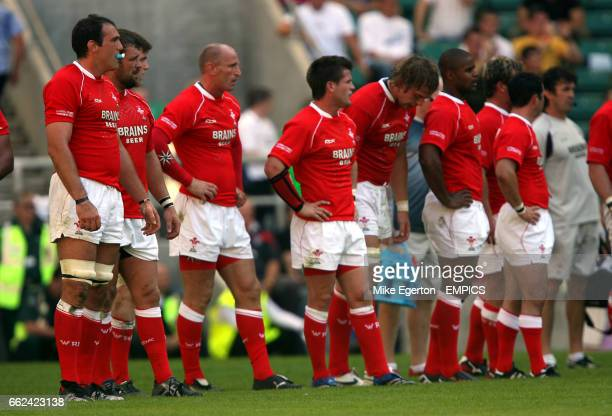 Wales' players stand dejected under the posts