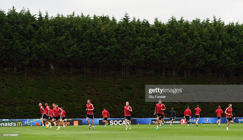 Wales players warm up during Wales training session ahead of their Euro 2016 quarter final match against Belgium at their base camp on June 30, 2016 in Lille, France.
