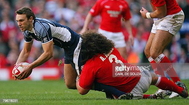 Wales' prop Adam Jones brings down Scotland's scrum half Mike Blair during their Six Nations Rugby Union match at the Millenium Stadium in Cardiff on...