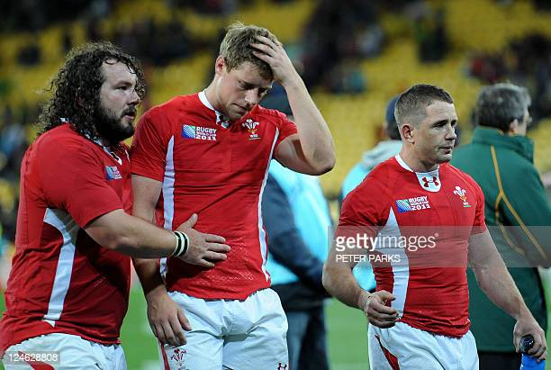 Wales prop Adam Jones flyhalf Rhys Priestland and left wing Shane Williams react after the 2011 Rugby World Cup pool D match South Africa vs Wales at...