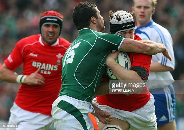 Wales Prop Adam Jones is tackled by Ireland's Robert kearney during the Six Nations rugby union international match at Croke Park Dublin on March 8...