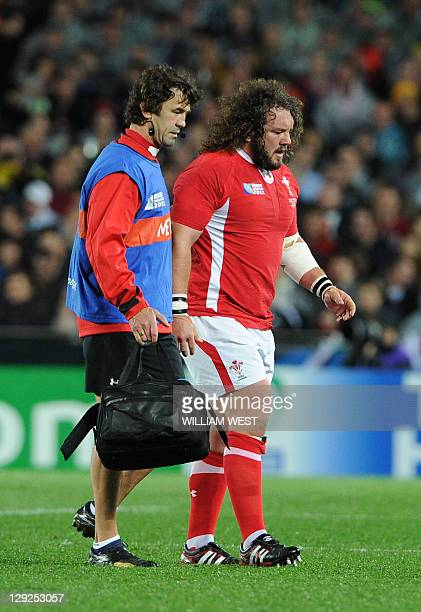 Wales' prop Adam Jones leaves the filed after injury during the 2011 Rugby World Cup semifianl match Wales vs France at the Eden Park in Auckland on...