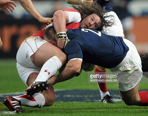 Wales prop Adam Rhys Jones fights for the ball with France's hooker William Servat during the 6Nations rugby union match France vs Wales on March 19...