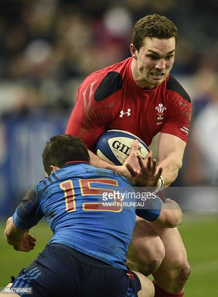 Wales' right wing George North is tackled by France's fullback Brice Dulin during the Six Nations international rugby union match between France and...
