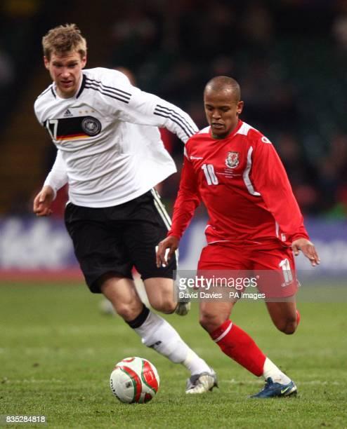 Wales' Robert Earnshaw avoids Germany's Per Mertesacker