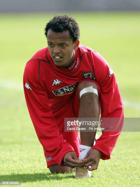 Wales' Robert Earnshaw ties his laces during a training session at Newport County Ground Tuesday October 4 2005 Wales are to play Northern Ireland in...