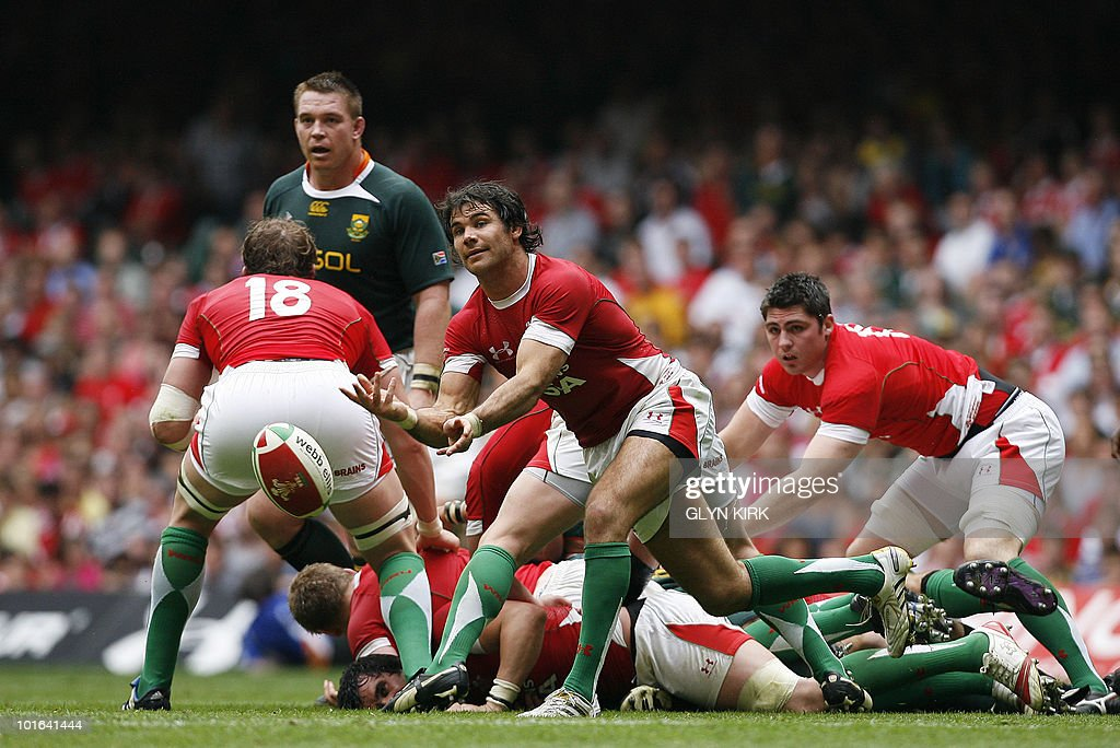 Wales' scrum half Michael Phillips passes the ball during an international friendly rugby match against South Africa at the Millennium Stadium in Cardiff, Wales on June 5, 2010.