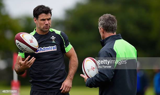 Wales scrum half Mike Phillips chats with coach Robert Howley during Wales training ahead of saturdays World cup warm up match against Ireland at the...