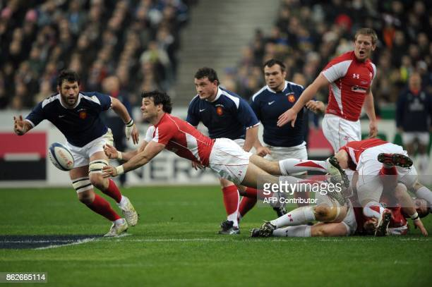 Wales scrum half Mike Phillips clears the ball in front of France's lock Lionel Nallet during the 6Nations rugby union match France vs Wales on March...