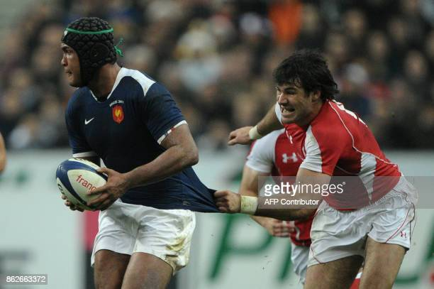 Wales scrum half Mike Phillips tries to stop France's captain and flanker Thierry Dusautoir during the 6Nations rugby union match France vs Wales on...