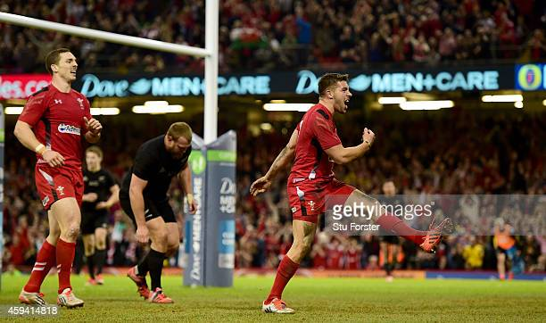 Wales scrum half Rhys Webb celebrates after scoring the first Wales try during the International match between Wales and New Zealand All Blacks at...