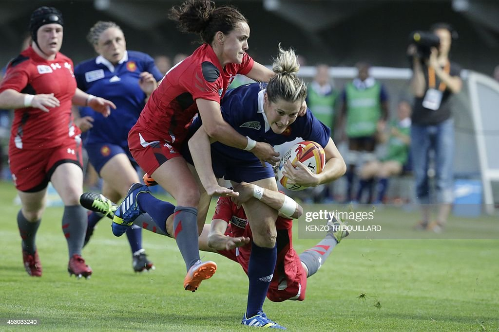 Wales' scrumhalf Amy Day (3rd L) tackles France's fullback Caroline Ladagnous (R) during the IRB Women's Rugby World Cup match between France and Wales at the French Rugby Federation headquarters in Marcoussis, near Paris, on August 1, 2014.