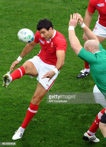 Wales' scrumhalf Mike Phillips kicks the ball in front of Ireland's lock Paul O'Connell during the 2011 Rugby World Cup quarterfinal match Ireland vs...