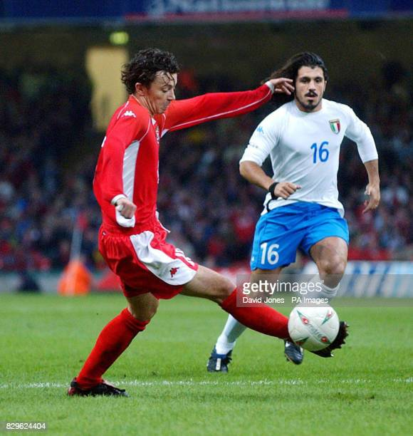 Wales' Simon Davies takes the ball away from Italy's Gennaro Ivan Gattuso during Euro 2004 Group 9 Qualifying match at the Millennium Stadium Cardiff