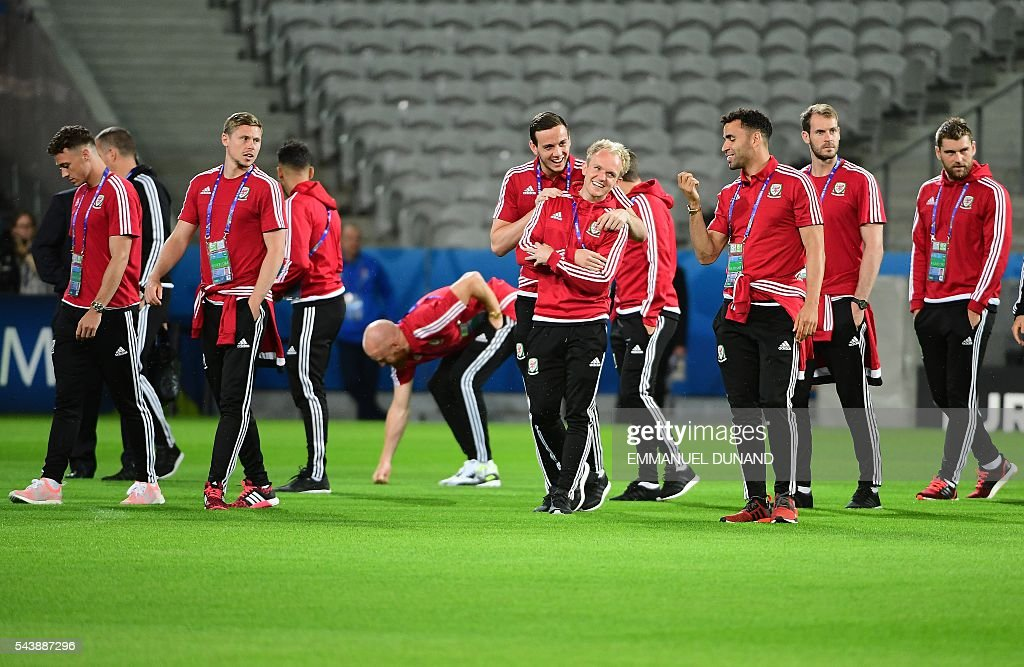 Wales soccer players round the Pierre-Mauroy stadium ahead of the match between Wales and Belgium during the Euro 2016, in Villeneuve-d'Ascq near Lille on June 30, 2016. / AFP / EMMANUEL