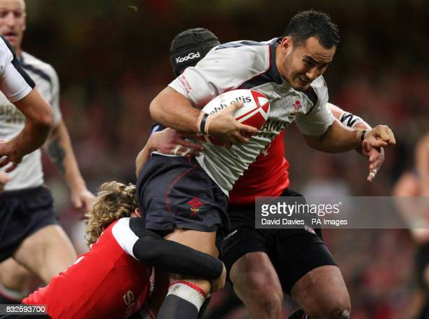 Wales' Sonny Parker is tackled by Canada's David Spicer and Mike Burak of during the international match at Millennium Stadium Cardiff