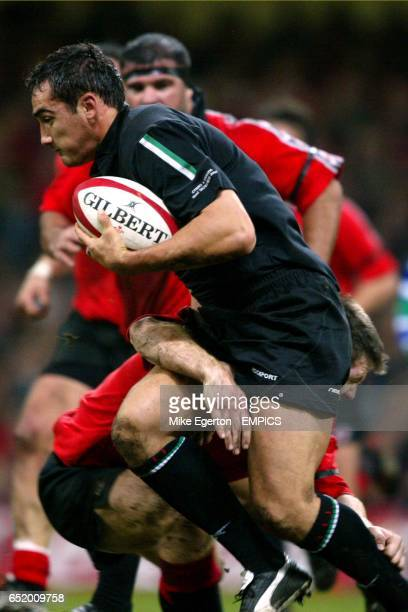 Wales' Sonny Parker is tackled by Canada's John Cannon