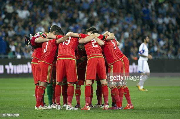 Wales' starting eleven huddle together ahead of the Euro 2016 qualifying football match between Israel and Wales at the Sammy Ofer Stadium in the...