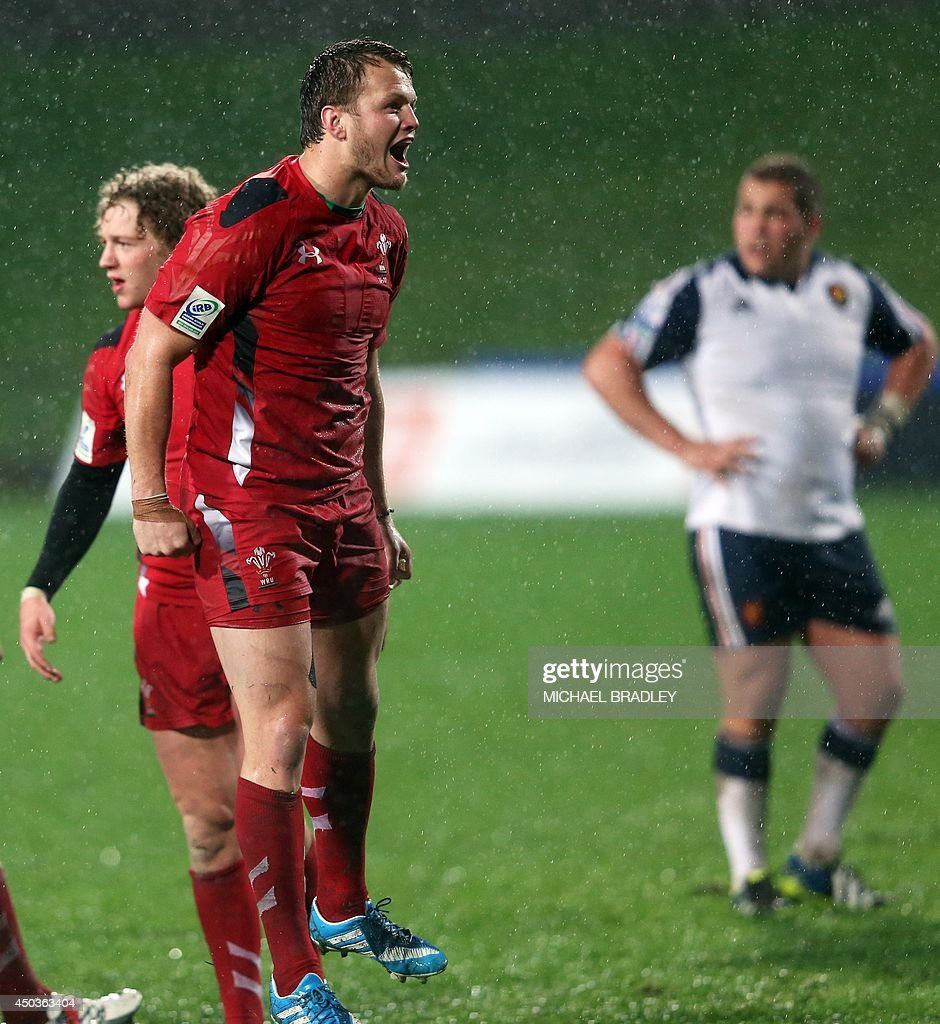 Wales' Steffan Hughes (C) celebrates their Welsh win during the U20 Junior World Championship rugby union match between France and Wales at QBE Stadium in Auckland on June 10, 2014. AFP PHOTO / Michael Bradley