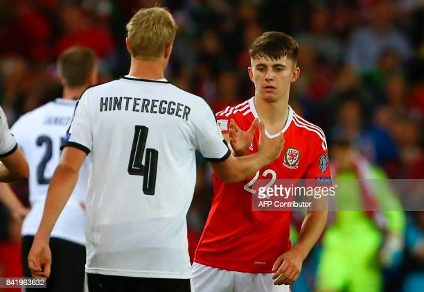 Wales' striker Ben Woodburn shakes hands with Austria's defender Martin Hinteregger at the final whistle of the FIFA World Cup 2018 qualification...