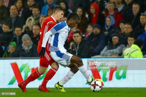 Wales' striker Ben Woodburn vies with Panama's striker Alfredo Stephens during the international friendly football match between Wales and Panama at...