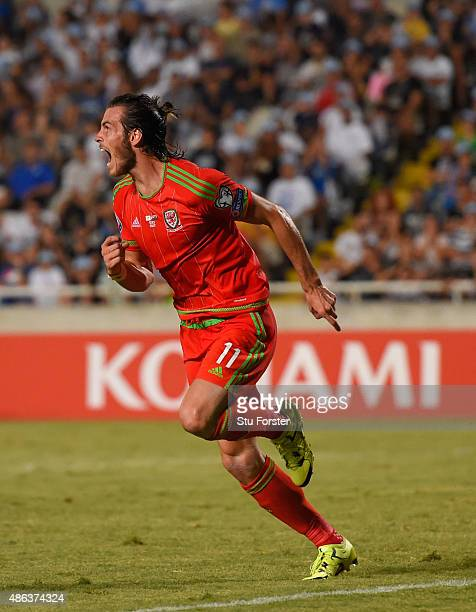 Wales striker Gareth Bale celebrates after scoring the opening goal during the UEFA EURO 2016 Qualifier between Cyprus and Wales at GPS Stadium on...