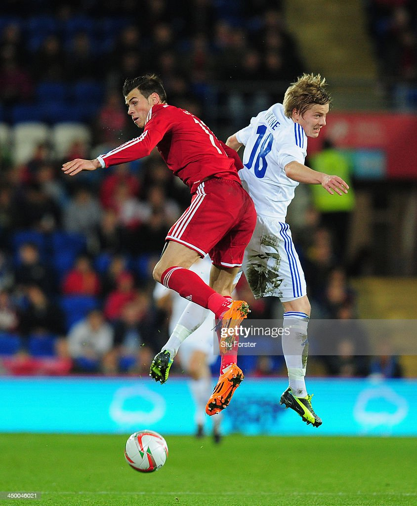 Wales striker Gareth Bale (l) challenges Jere Uronen of Finland during the International Friendly match between Wales and Finland at Cardiff City Stadium on November 16, 2013 in Cardiff, Wales.