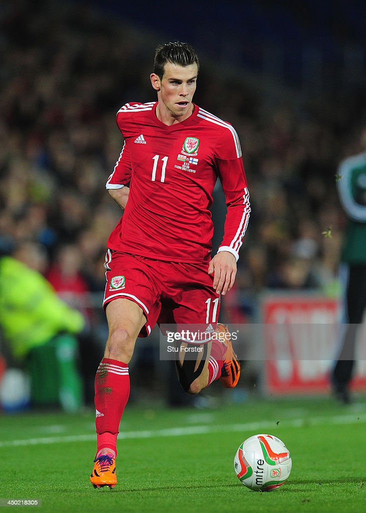 Wales striker <a gi-track='captionPersonalityLinkClicked' href=/galleries/search?phrase=Gareth+Bale&family=editorial&specificpeople=609290 ng-click='$event.stopPropagation()'>Gareth Bale</a> in action during the International Friendly match between Wales and Finland at Cardiff City Stadium on November 16, 2013 in Cardiff, Wales.