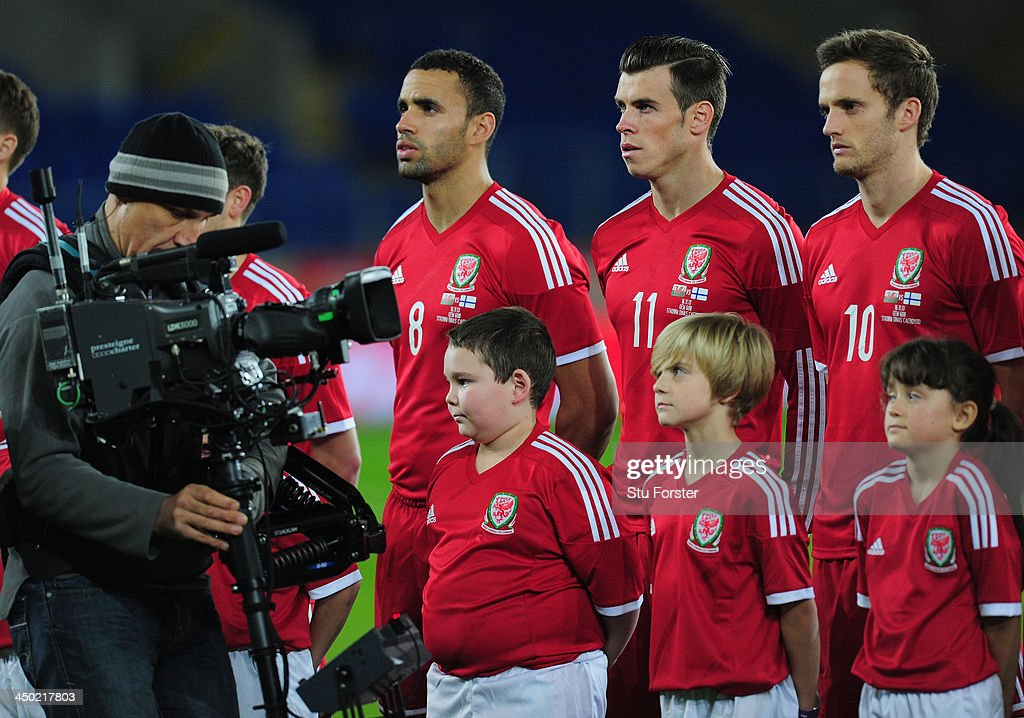 Wales striker Gareth Bale (c) looks on during the team line up before the International Friendly match between Wales and Finland at Cardiff City Stadium on November 16, 2013 in Cardiff, Wales.