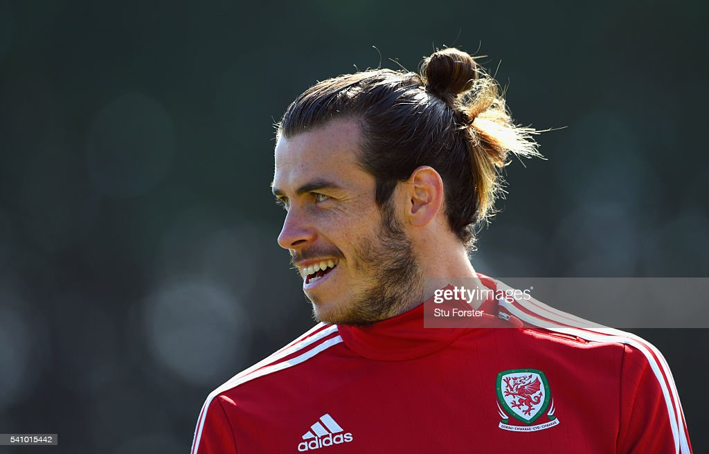 Wales striker <a gi-track='captionPersonalityLinkClicked' href=/galleries/search?phrase=Gareth+Bale&family=editorial&specificpeople=609290 ng-click='$event.stopPropagation()'>Gareth Bale</a> raises a smile during Wales training at their Euro 2016 basecamp on June 18, 2016 in Dinard, France.
