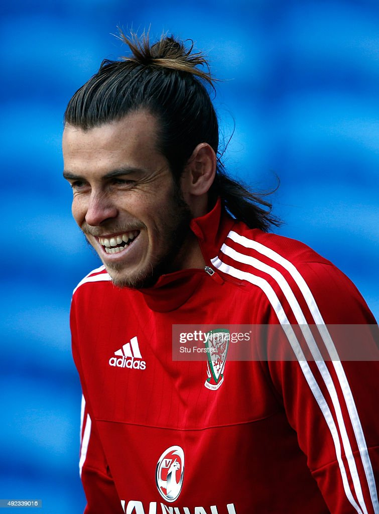 Wales striker Gareth Bale raises a smile during Wales trsaining ahead of the match against Andorra at Cardiff City stadium on October 12, 2015 in Cardiff, United Kingdom.