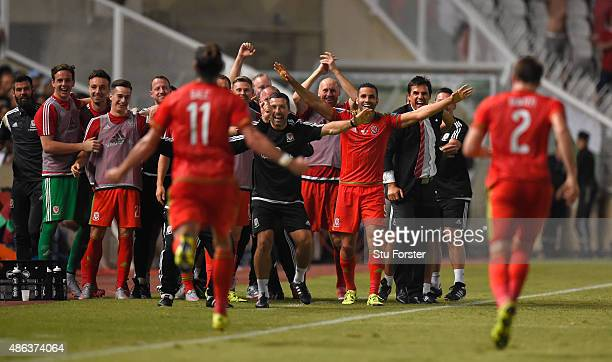 Wales striker Gareth Bale runs over to the bench to celebrate after scoring the opening goal during the UEFA EURO 2016 Qualifier between Cyprus and...
