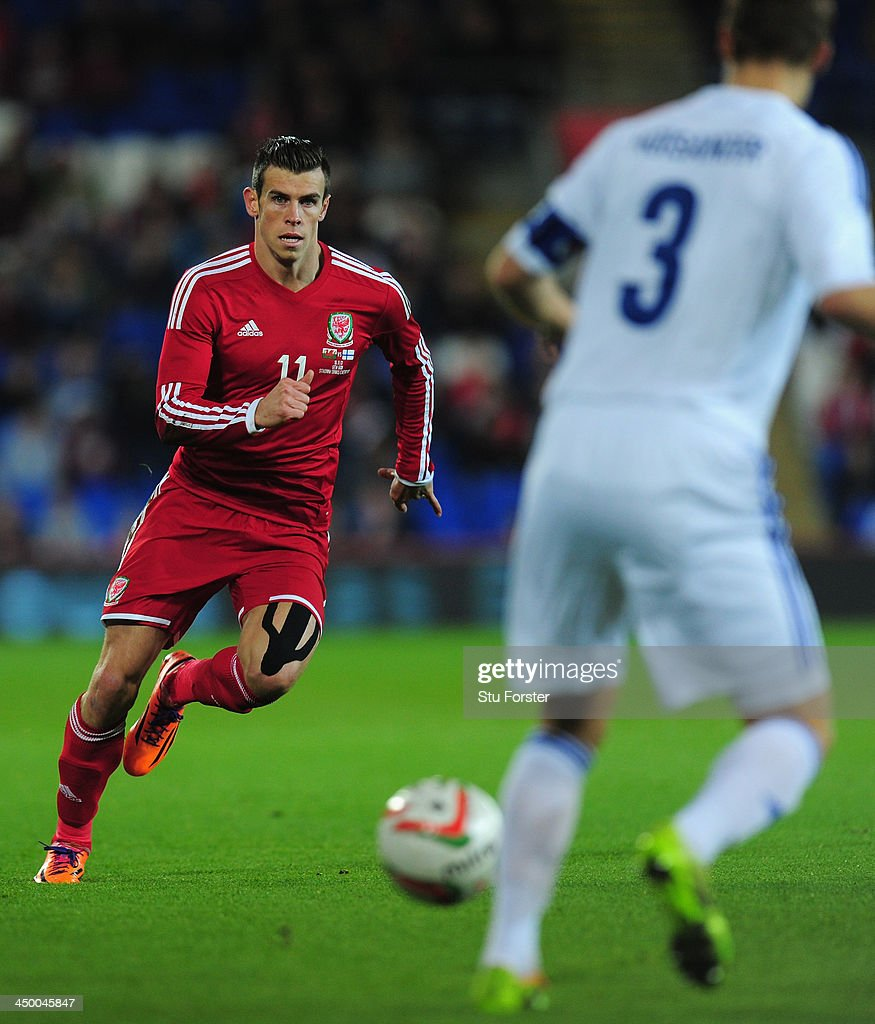 Wales striker Gareth Bale takes on the Finland defence during the International Friendly match between Wales and Finland at Cardiff City Stadium on November 16, 2013 in Cardiff, Wales.