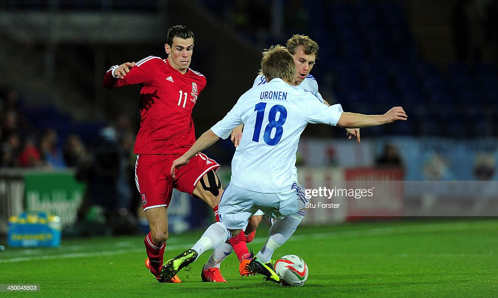 Wales striker Gareth Bale takes on the Finland defence uring the International Friendly match between Wales and Finland at Cardiff City Stadium on November 16, 2013 in Cardiff, Wales.