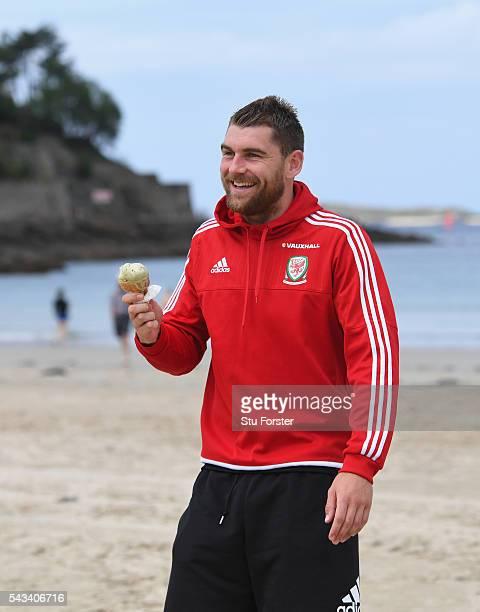 Wales striker Sam Vokes enjoys an Ice Cream and a stroll on Dinard beach on June 28 2016 in Dinard France
