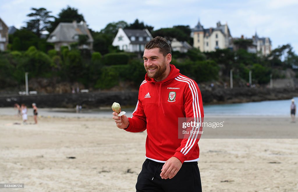 Wales striker <a gi-track='captionPersonalityLinkClicked' href=/galleries/search?phrase=Sam+Vokes&family=editorial&specificpeople=4778614 ng-click='$event.stopPropagation()'>Sam Vokes</a> enjoys an Ice Cream and a stroll on Dinard beach on June 28, 2016 in Dinard, France.