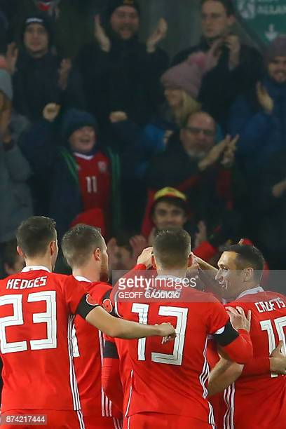 Wales' striker Tom Lawrence celebrates with teammates scoring the team's first goal during the international friendly football match between Wales...